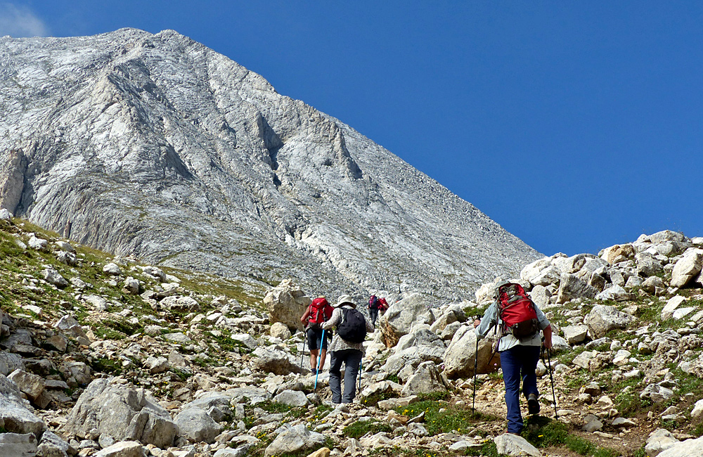 climbing vihren summit in pirin mountains, bulgaria
